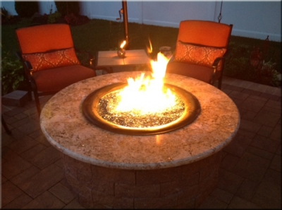 patio propane fireplace. Notice the patio umbrella  which if placed at least 60 inches above fire pit will further help keep heat around sitting area Clean burning outdoor firepits Propane burner authority and