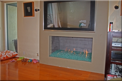 Fireplace pictures using fire rocks and fire glass for home and outdoor fire pits.
