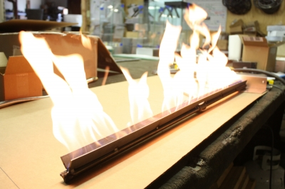 Create a linear flame with a ribbon burner by Moderustic.