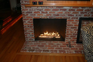 fire burner in a brick fireplace