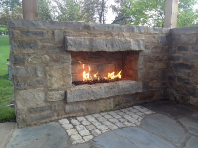 Stainless steel burners are the recommended type of metal for outdoor fireplaces.  See our outdoor fireplaces with fireglass.