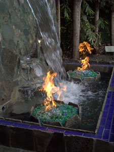 Natural gas fire pit with waterfall