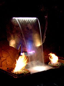 custom waterfall with fireglass fire pits