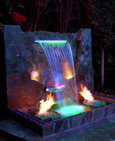 waterfall with colored lights and fire