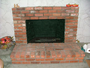burner in brick fireplace