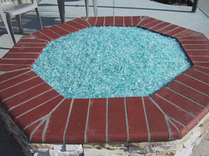 outdoor firepit with fire glass rocks