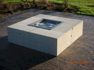 This is a natural gas fire pit. It was tested as soon as it turned dark,  fun! Now we add the crushed lava rock and glass over that. - How To Make A Wood Table Into An Outdoor Fire Pit With Glassel