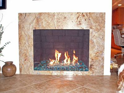 The fireplace below has Bronze Rust Copper Base Glass, Ford Blue Base Glass  and Yellow Amber Topper - Yellow Amber Fire Pit And Fireplace Glass Stones Rocks, Fireplace