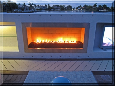 outdoor propane fireplace feature with lava rock and custom ribbon burner