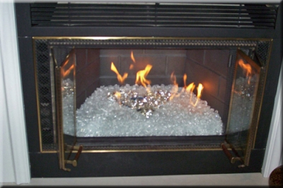 Fireplaces With Glass Rocks That Coupled With The Glass Had Made The Fireplace A Focal Point To