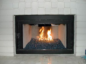 A rich brilliant blue fireplace glass ford blue for Firerock fireplace cost